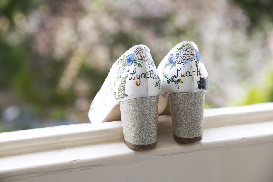 personalised Rainbow wedding shoes with couple's names and illustrations of their cats