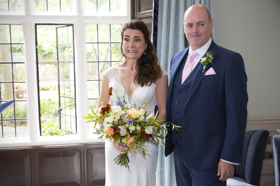 bride and groom pulling funny face when asked if anyone objects during wedding ceremony at Lewes Register Office