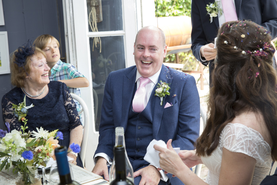 groom laughs during wedding speeches at Limetree Kitchen in Lewes