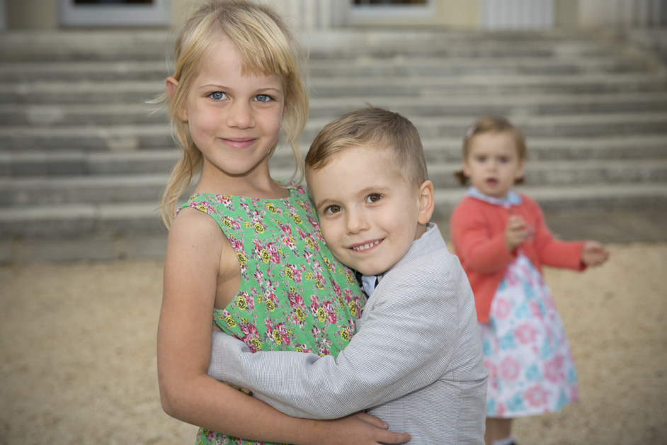children hugging at Stoke Park wedding reception in Reading