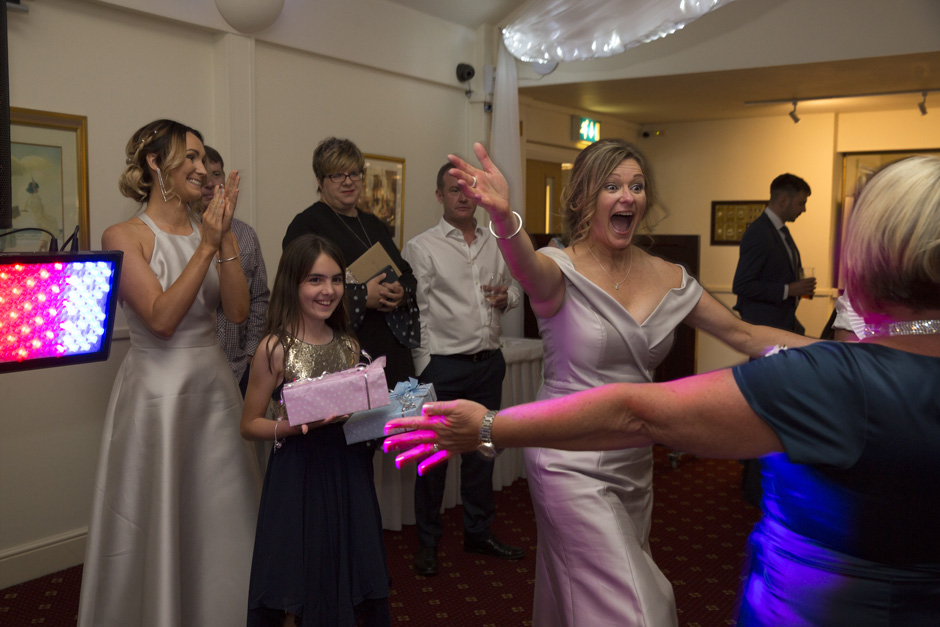 Bride very excited to greet the winner of her quiz at Weald of Kent wedding in Kent.