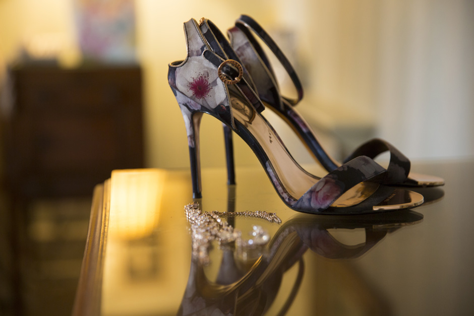 bride's wedding shoes and jewellery in bedroom at The Old Rectory at Hartwell House in Buckinghamshire
