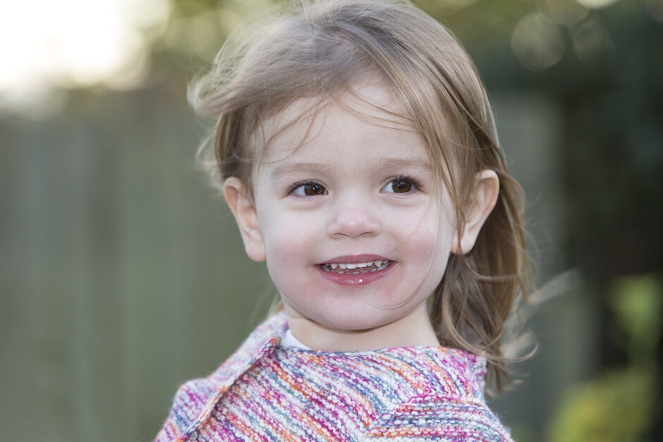 little girl smiling in her garden in Plaxtol, Kent