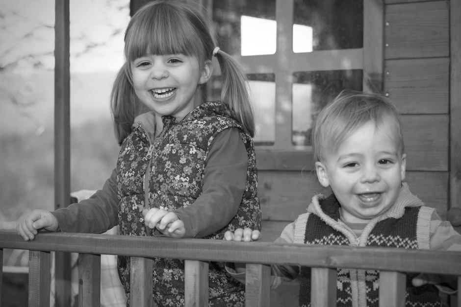 little girl and her toddler brother playing in their treehouse in Tonbridge, Kent