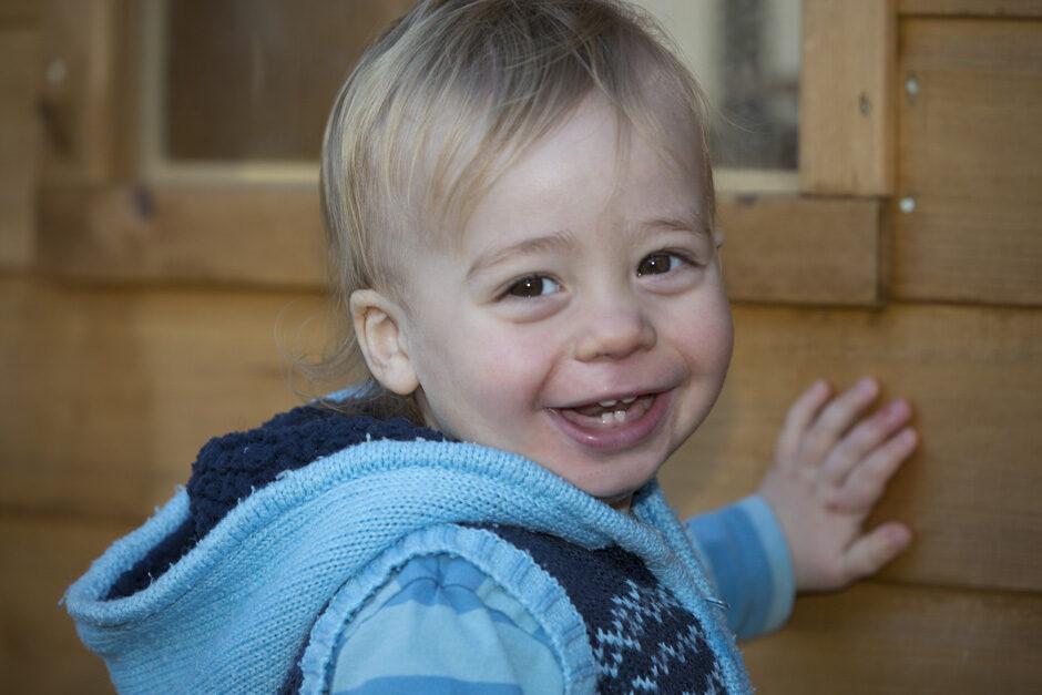 toddler boy smiling in his treehouse in Tonbridge, Kent