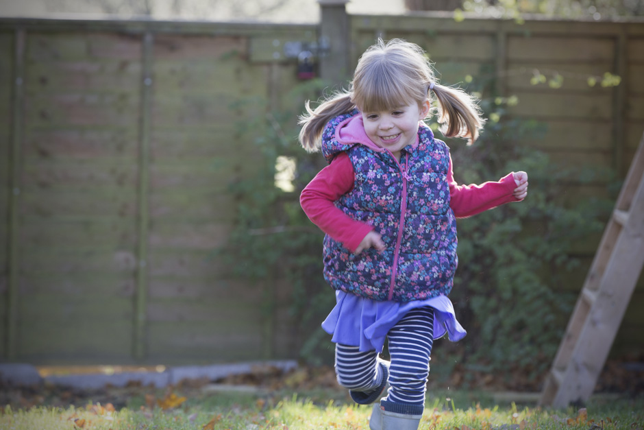 little girl running in her garden in Tonbridge, Kent