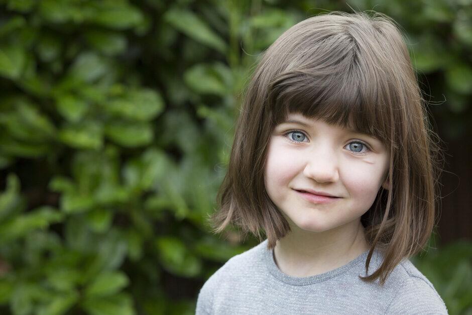 little girl in her garden in Tonbridge, Kent