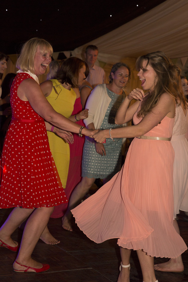 guests dancing at evening wedding reception at Smarden village home marquee in Kent