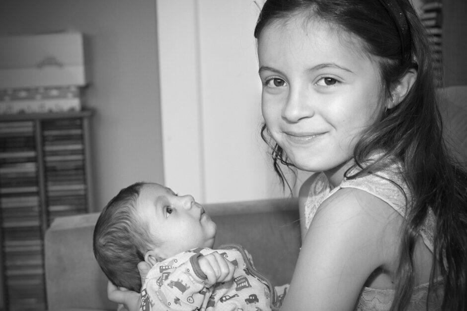 little girl holding her baby brother in Tonbridge, Kent