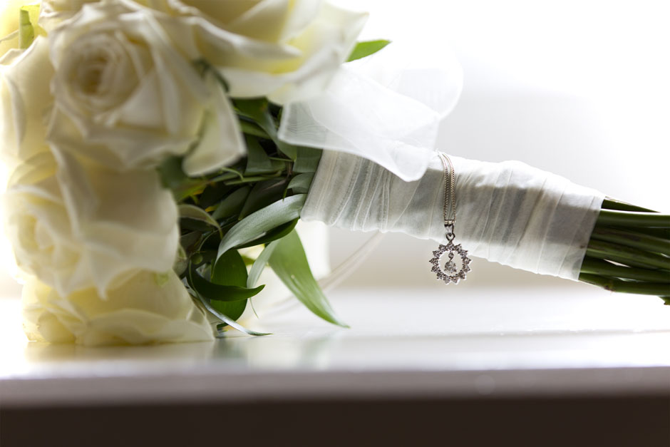 Bride's necklace captured on bouquet at Wotton House, Dorking in Surrey