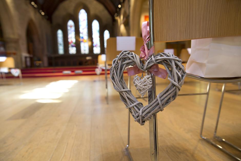 Wooden heart chair decoration at St Stephen's Church wedding in Tonbridge, Kent.