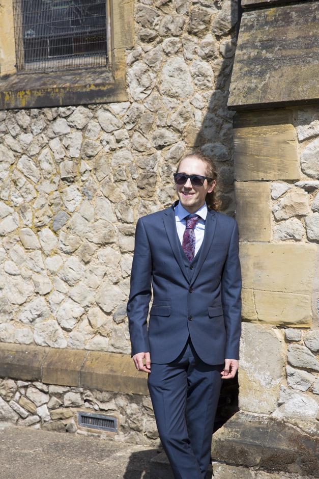 Wedding guest outside St Stephen's Church in Tonbridge, Kent