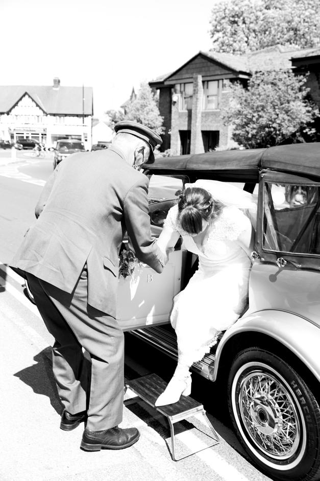 Bride arriving at Lynch Gate entrance at St Stephen's Church in Tonbridge, Kent