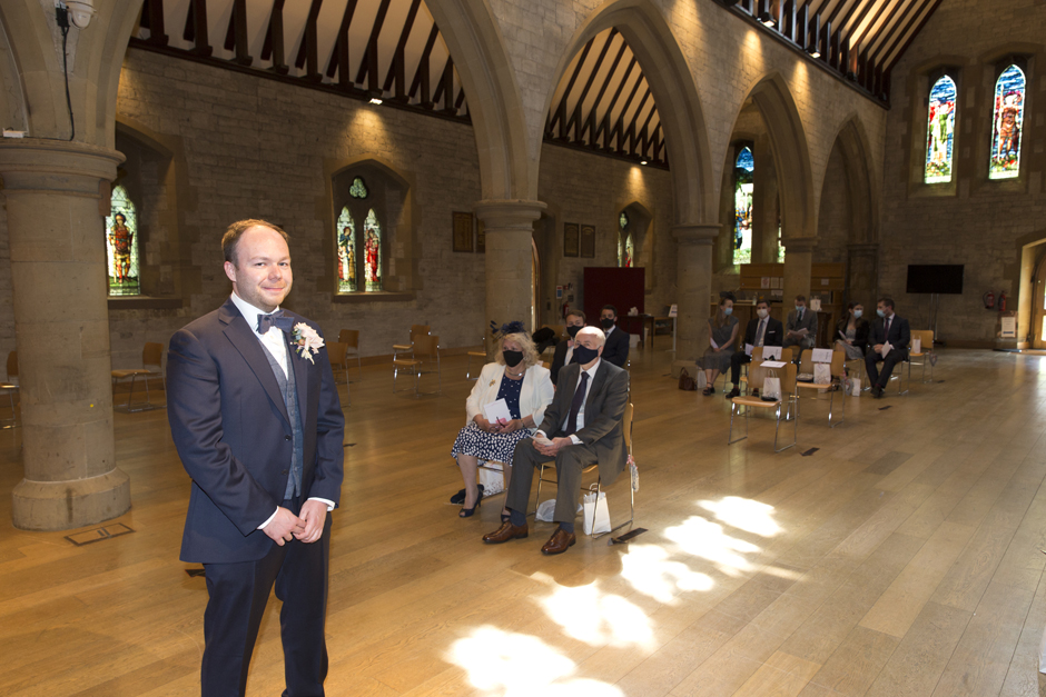 Groom waiting for bride with guests at St Stephen's Church in Tonbridge, Kent