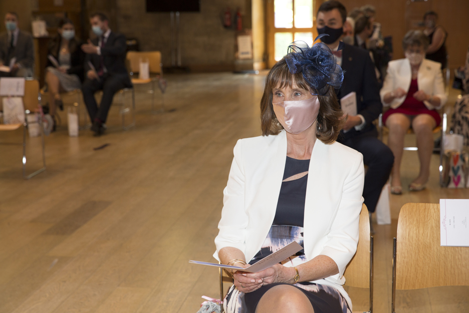 Mother of the bride wearing face mask inside St Stephen's Church, Tonbridge in Kent