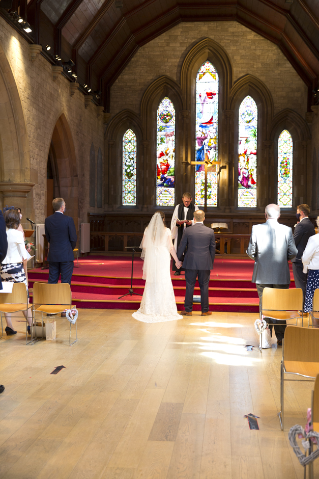 Back of bride and groom at St Stephen's Church wedding in Tonbridge, Kent