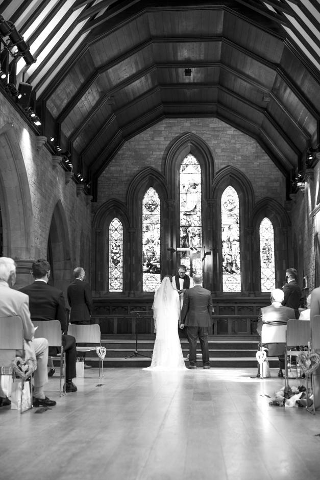 Back of bride and groom showing St Stephen's Church wedding in Tonbridge, Kent