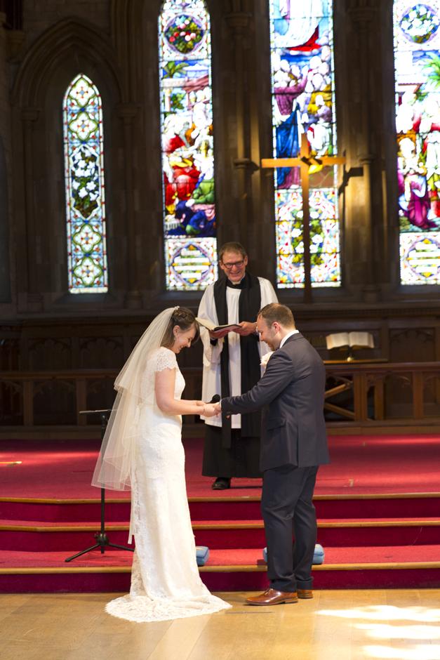 Bride and Groom exchanging rings at St Stephen's church wedding in Tonbridge, Kent