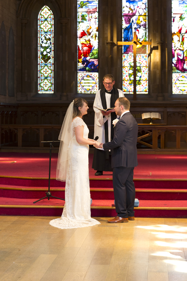 Bride and Groom exchanging vows at St Stephen's Church wedding in Tonbridge, Kent