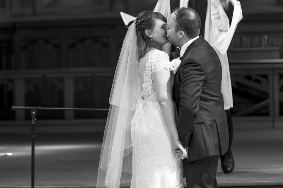 Bride and Groom kiss during St Stephen's church wedding ceremony in Tonbridge, Kent