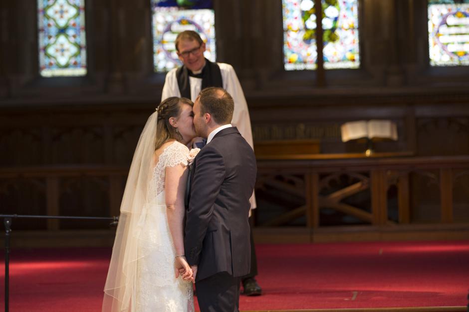 Bride and Groom kiss at St Stephen's Church wedding in Tonbridge, Kent