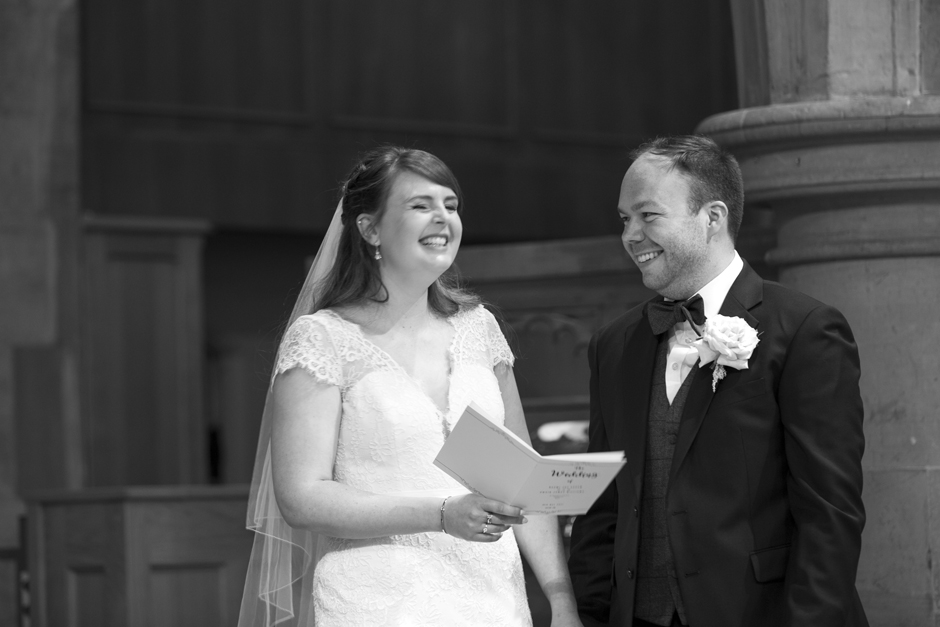 Bride and Groom laughing during St Stephen's Church wedding ceremony in Tonbridge, Kent
