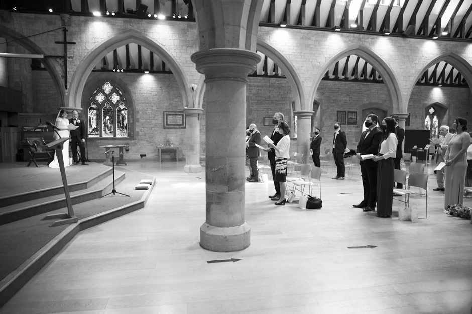 Bride and Groom with socially distant wedding guests wearing masks at St Stephen's Church in Tonbridge, Kent