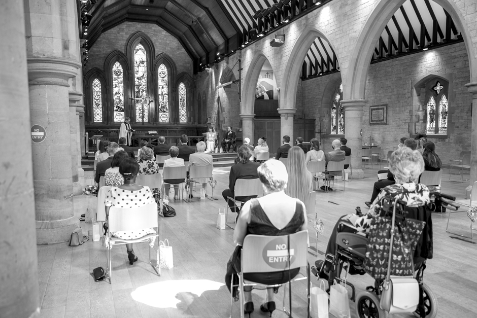 Socially distant guests at wedding ceremony in St Stephen's Church in Tonbridge, Kent