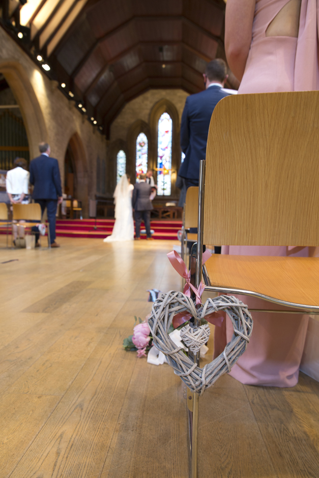 Woven Wooden chair decoration at wedding ceremony at St Stephen's Church in Tonbridge, Kent