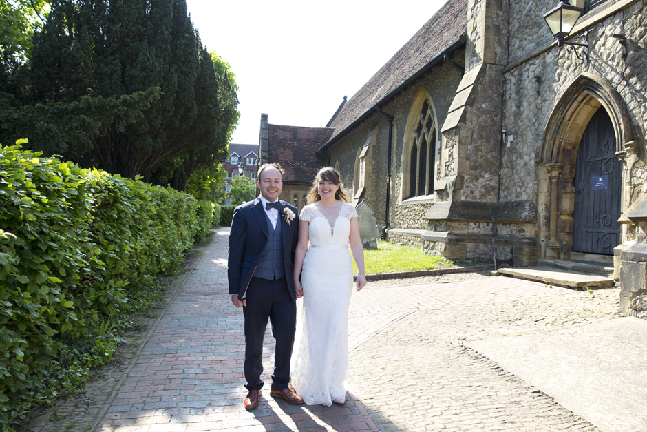 Bride and Groom outside church path at St Stephen's Church wedding in Tonbridge, Kent