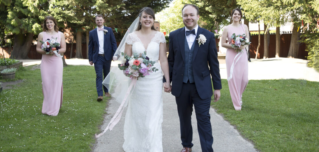 Bride and Groom walking with best man and bridesmaids at socially distant wedding in Tonbridge, Kent