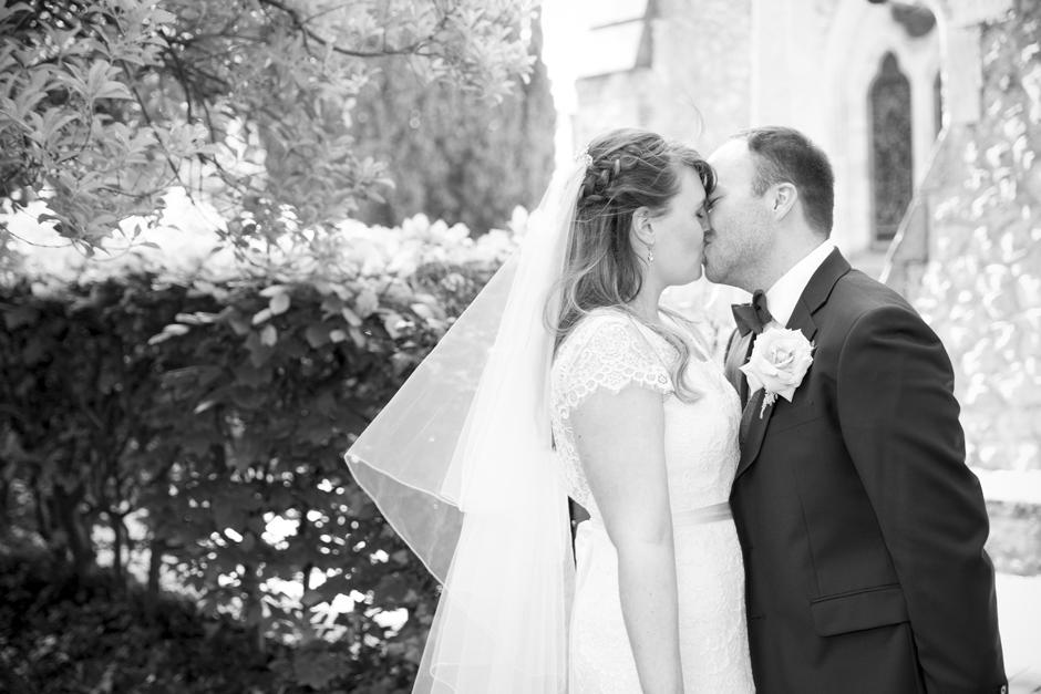 Bride and Groom kissing portrait at St Stephen's Church in Tonbridge, Kent.