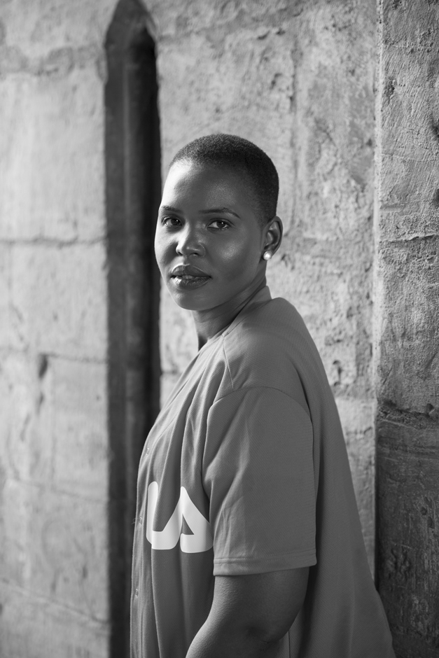 Black woman portrait taken at Tonbridge Castle ( captured in black and white by Kent photographer Victoria Green)