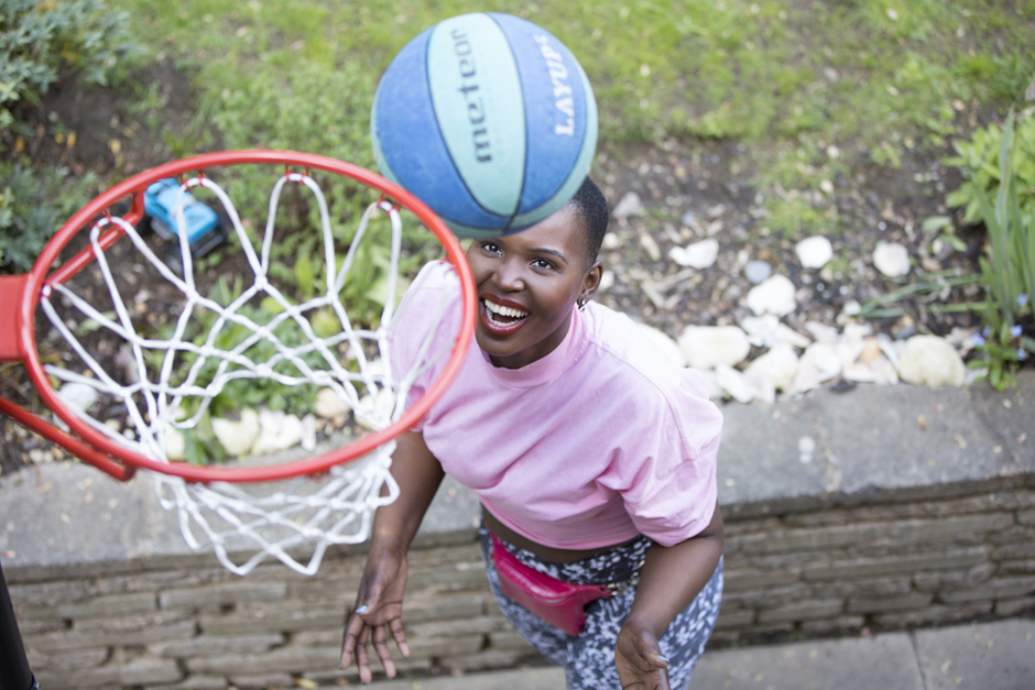 Black woman throwing a basketball in the hoop captured by Kent photographer Victoria Green