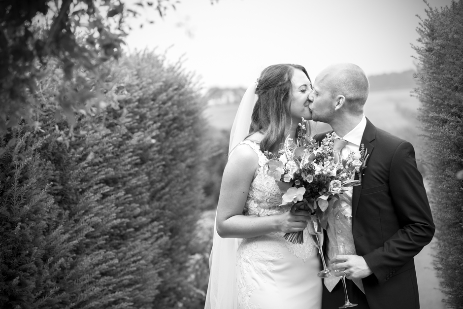 Bride and groom sharing an intimate kiss at Nettlestead Place wedding. Captured by Victoria Green Photography.