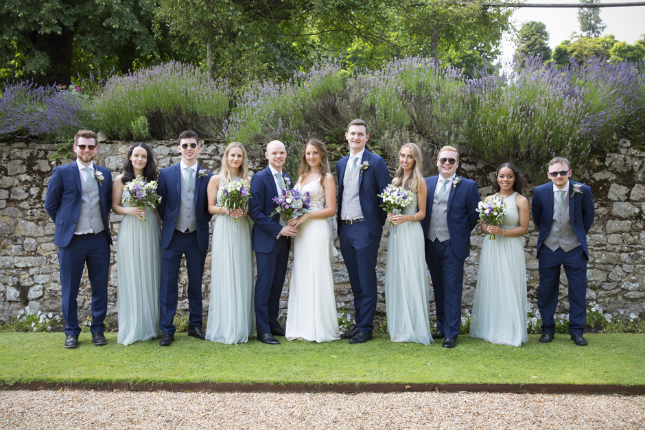 Bride and groom with groomsmen and bridesmaids at Nettlestead Place wedding in Kent.