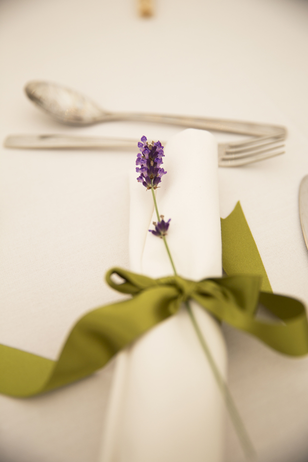 Sprig of lavender on table at Nettlestead Place wedding in Kent.