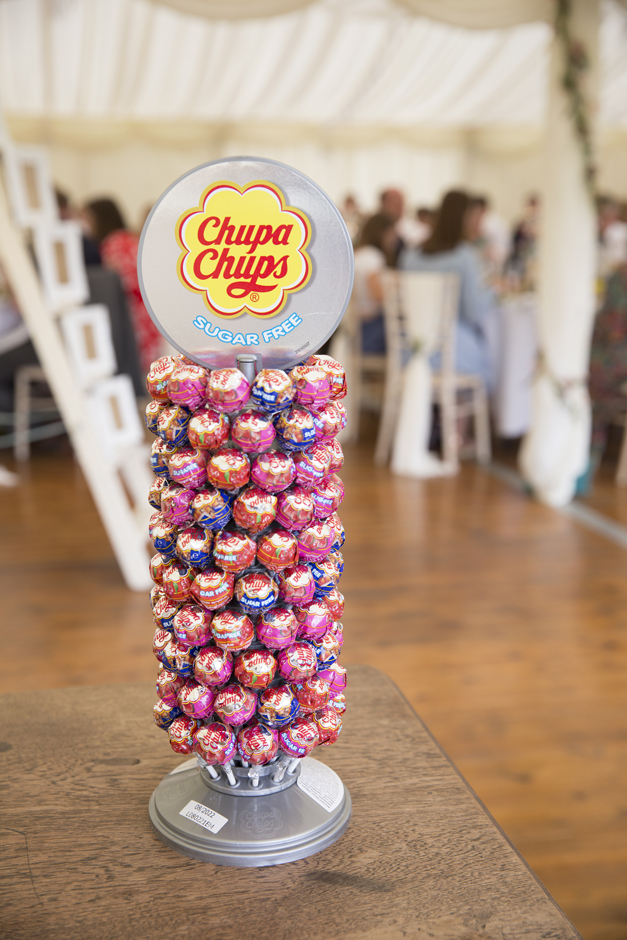 Chuppa chups stand on wedding table at Nettlestead Place, Maidstone in Kent.