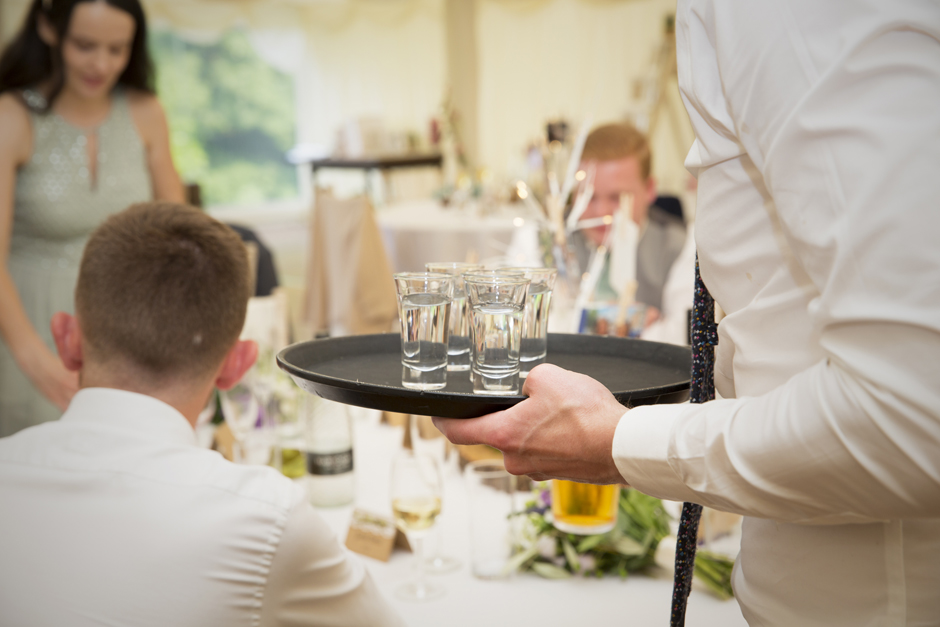 Tequila shots on a tray at Nettlestead Place wedding in Maidstone, Kent.