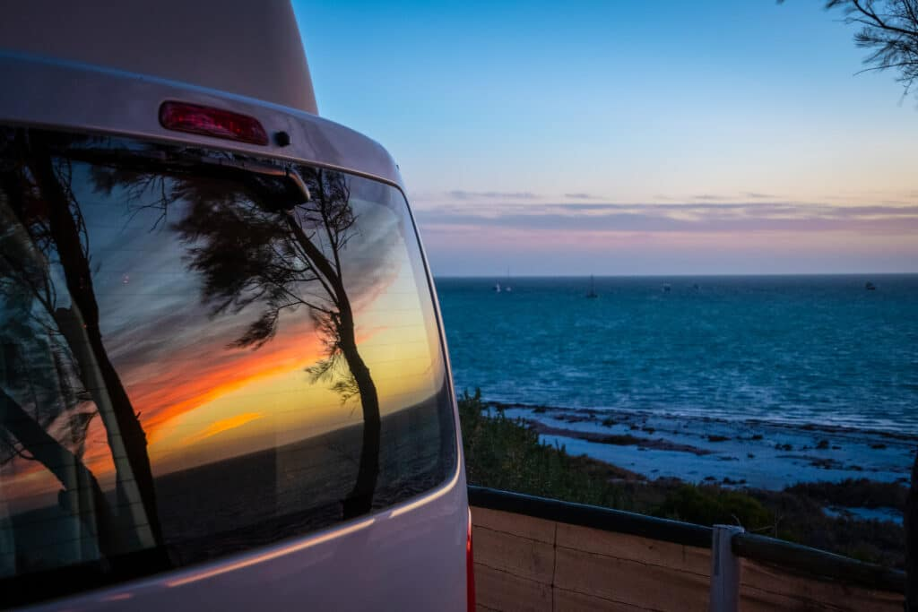 the sunset reflection in a campervan window