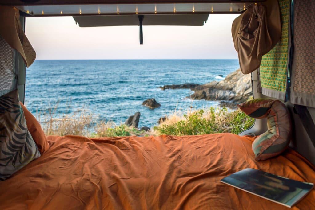 A cosy Campervan bed overlooking the sea