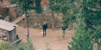 Randy Weaver in front of his house at Ruby Ridge