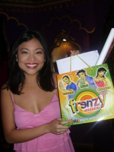 One of the participants holds up her loot bag of Frenzy condoms