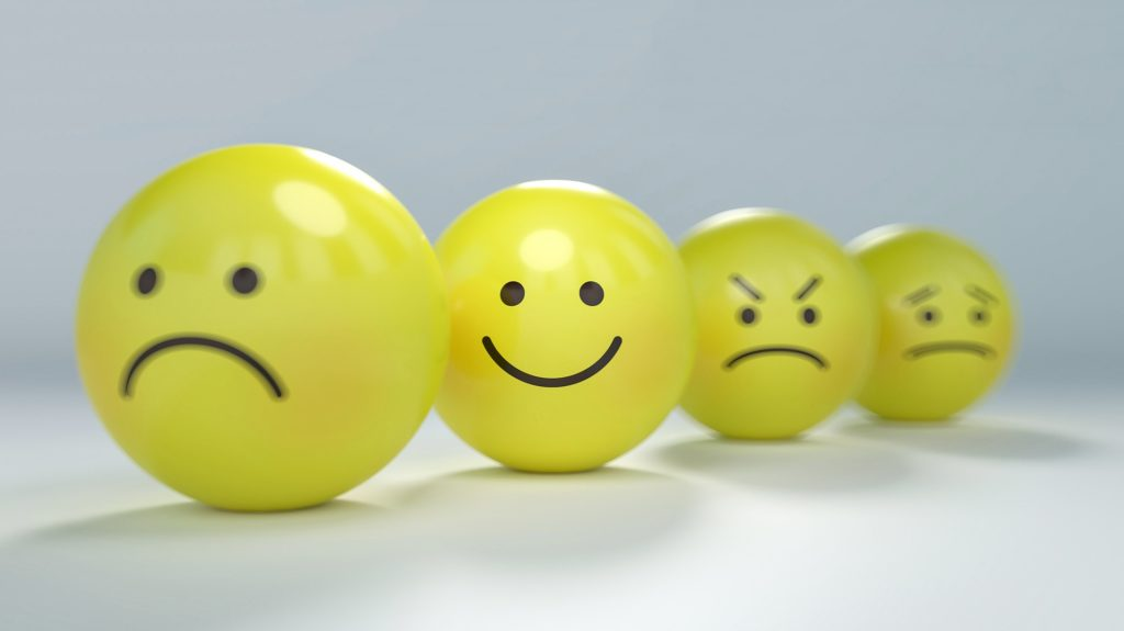 Pingpong balls with different expressions, representing  emotional intelligence