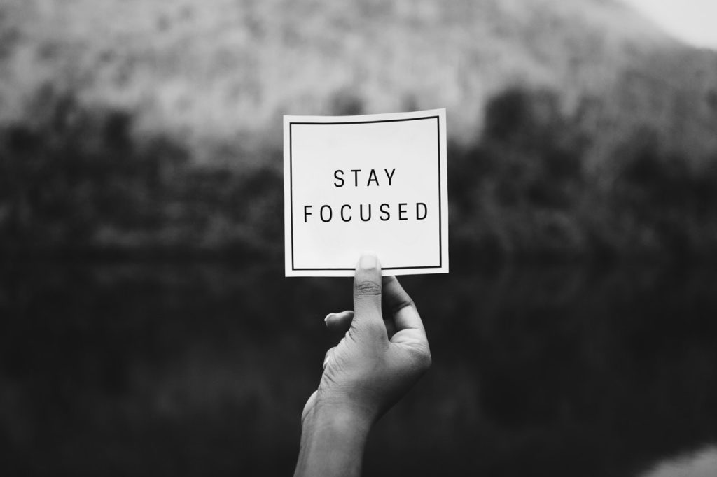 A sign saying stay focused, representing self motivation which is a key part of emotional intelligence