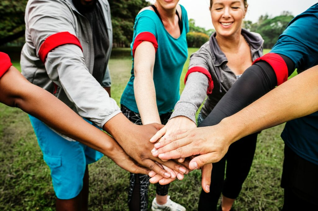 People placing hands on top of each other - something that might happen in Team Building Activities
