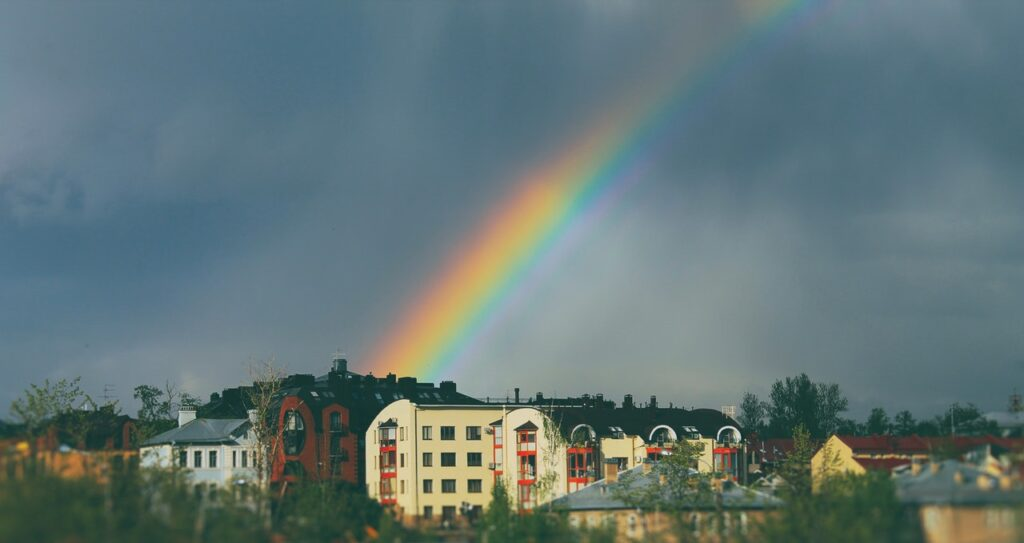 A rainbow, the colors representing those of DISC Personality Assessments