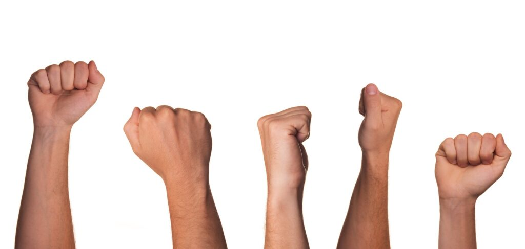 A clenched fist representing the resistance stage of the change curve