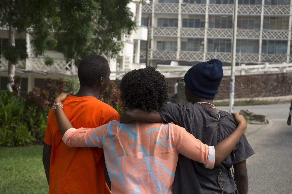 A group hugging representing a great outcome from the self-revealed stereotypes activity