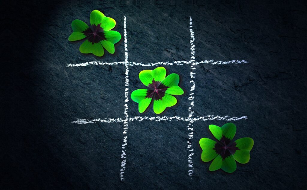 three four-leaf clovers, representing the role that luck plays in Leadership and Cultures for Innovation